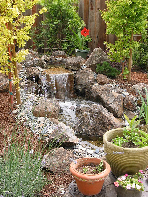 Morgan hill pondless waterfall and stream contractor Backyard pond ideas with waterfall